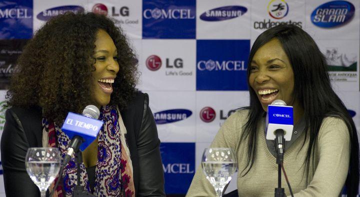 Serena and Venus laugh during a press conference in Bogota