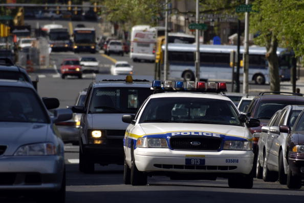 A Philadelphia police patrol car drives up 19th Street in Ph