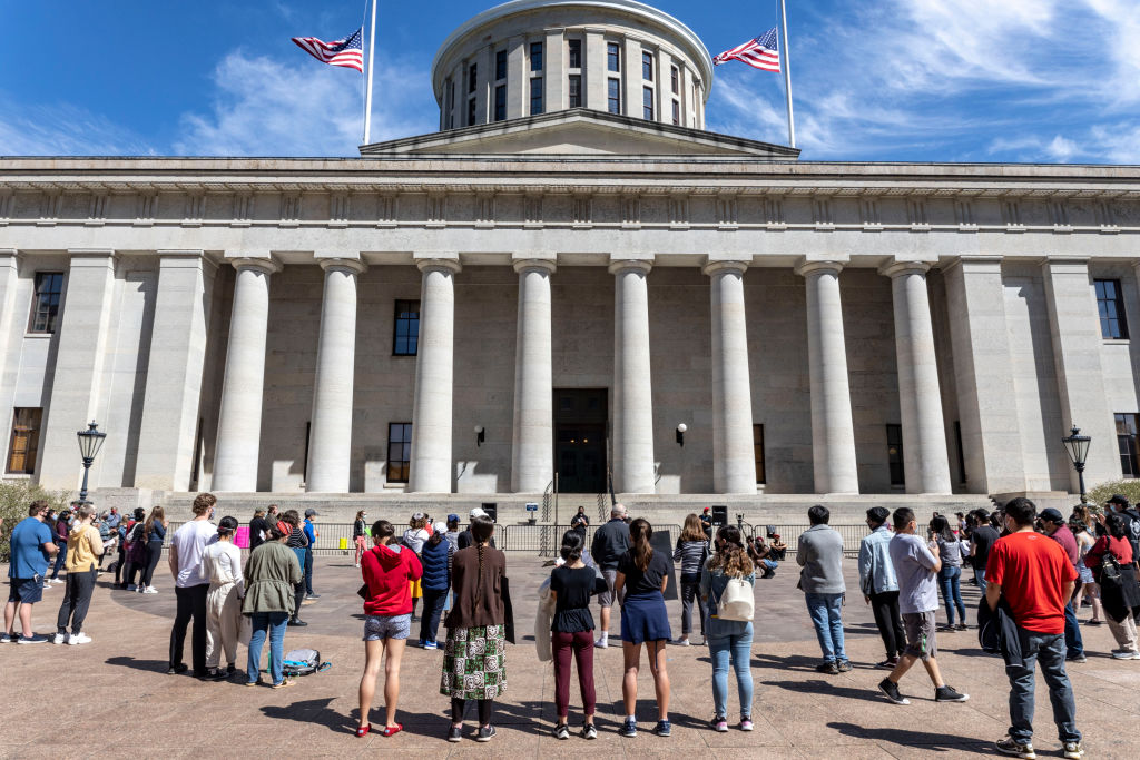 Supporters of Asian Solidarity stand in front of the Ohio...