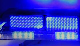 Bright blue colored police car lights flashing
