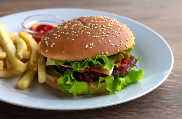 Burger with French fries and barbecue sauce