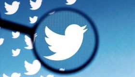 In this photo illustration a Twitter logo is seen on a...