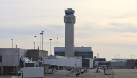Airport tower and tarmac area with passenger loading equipment