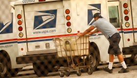 Mail carriers loading their trucks at the United States Postal Service in Van Nuys, California for story on USPS delays