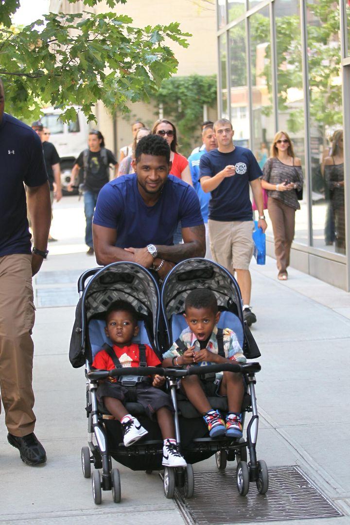 Usher Raymond pushes his sons, Usher Raymond V and Naviyd Raymond